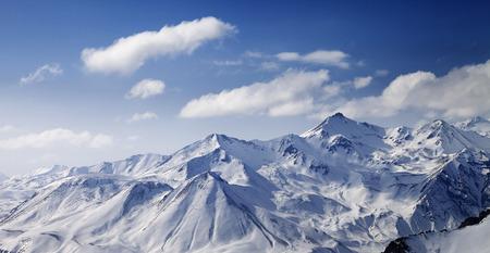off piste: Snowy winter mountains in sun day. Caucasus Mountains, Georgia. Panoramic view from ski resort Gudauri.