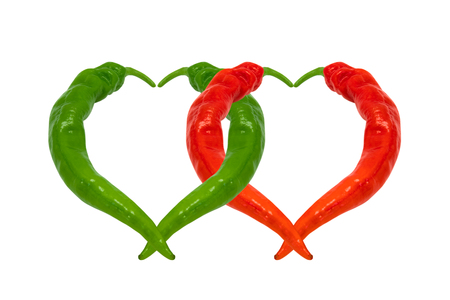 Red and green chili peppers in love. Hearts composed of peppers isolated on white background. photo