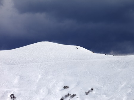 offpiste: Off-piste slope and storm gray sky in bad weather day. Caucasus Mountains, Georgia.
