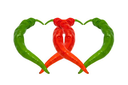Two hearts composed of red and green chili peppers. Isolated on white background. photo