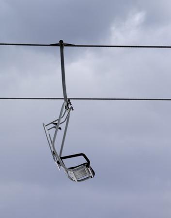 chairlift: Chair-lift and gray sky. Caucasus Mountains. Georgia, ski resort Gudauri.