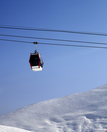 off piste: Gondola lift and off piste slope at sun morning. Caucasus Mountains, Georgia. Ski resort Gudauri.