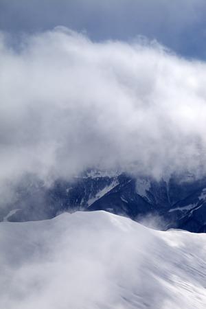 offpiste: Off-piste slope at mist. Caucasus Mountains, Georgia, ski resort Gudauri. Stock Photo