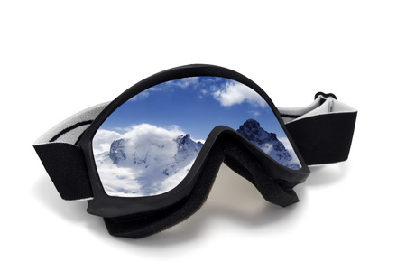 Ski goggles with reflection of winter mountains. Isolated on white background photo