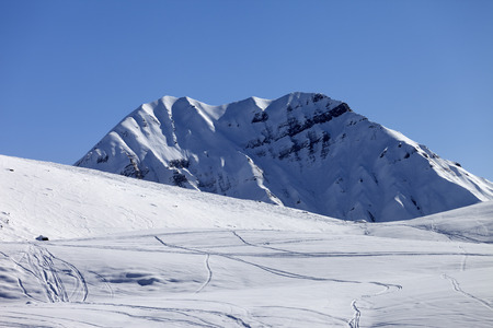 offpiste: Off-piste slope in sun morning. Georgia, ski resort Gudauri. Caucasus Mountains. Stock Photo