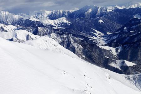 offpiste: Off-piste slope and snowy mountains. Caucasus Mountains, Georgia. Ski resort Gudauri. Stock Photo