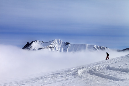 offpiste: Snowboarder on off-piste slope with newly fallen snow. Ski resort Gudauri. Caucasus Mountains, Georgia. Stock Photo