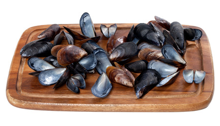saltwater pearl: Shells of mussels on wooden board. Isolated on white background.