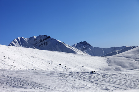 off piste: Off piste slope at nice sunny morning. Georgia, ski resort Gudauri. Caucasus Mountains. Stock Photo