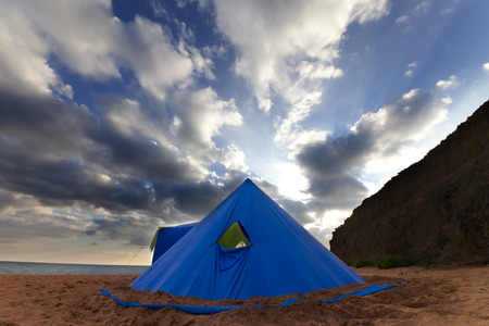 tipi: Conical tent on summer beach in evening.Wide angle view.