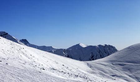 offpiste: Off-piste slope at nice sunny day. Georgia, ski resort Gudauri. Caucasus Mountains.