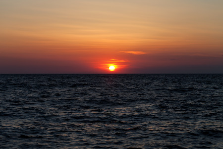 uprise: Sea at sunset in summer