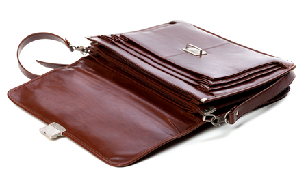 Open leather briefcase. Isolated on white background. photo