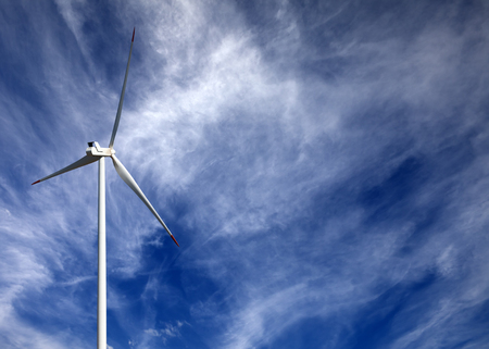 Wind turbine and blue sky with clouds at sun day photo