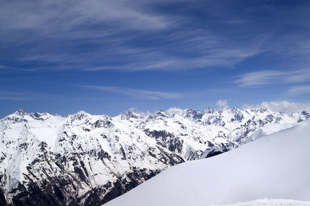 offpiste: Off-piste slope and snowy mountains. Caucasus Mountains. View from ski resort Dombay on Elbrus region.