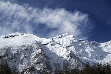 offpiste: View on off-piste ski slope at sun windy day. Caucasus Mountains, mount Cheget, Elbrus region.