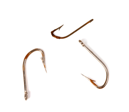 fishing rig: Three rusty old fishhook. Isolated on white background.