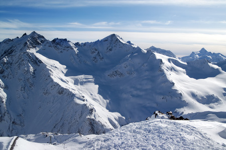 offpiste: Snowy off-piste slopes at evening. Caucasus Mountains. View from ski slope of Mount Elbrus.
