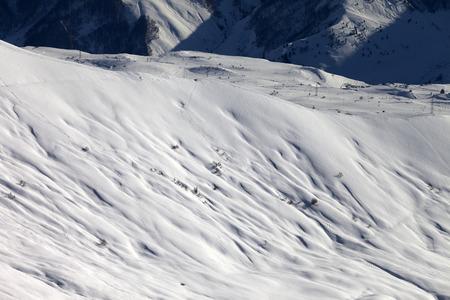 offpiste: Top view on off-piste slope at evening. Caucasus Mountains, Georgia, ski resort Gudauri.