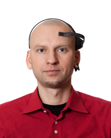 Portrait of young man with EEG (electroencephalography) headset on head. Isolated on white background.