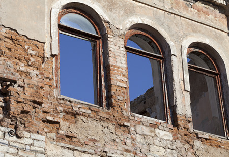 kaput: Brick wall of old destroyed house without windows Stock Photo