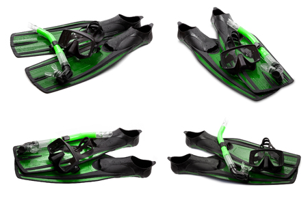 swim mask: Set of green swim fins, mask and snorkel for diving isolated on white background Stock Photo