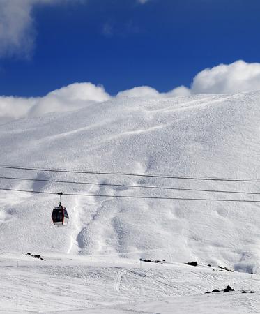 offpiste: Gondola lift and off-piste slope at sun day. Caucasus Mountains, Georgia. Ski resort Gudauri. Stock Photo