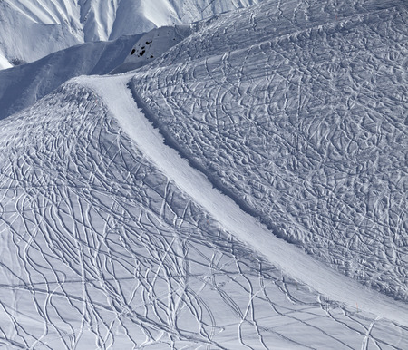 offpiste: Off-piste and groomed slope with trace from ski and snowboards on Caucasus Mountains, Georgia Stock Photo