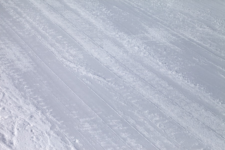 snow grooming machine: Background of ski slope with trace from snowcat Stock Photo