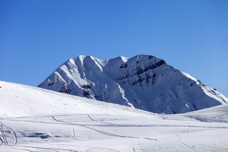 offpiste: Off-piste slope in sun morning. Caucasus Mountains. Georgia, ski resort Gudauri.
