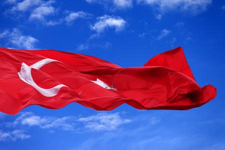 brandish: Waving flag of Turkey against blue sky at nice day