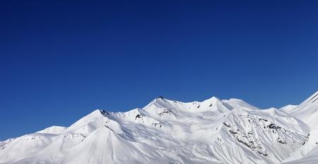 heli: Panoramic view on snowy mountains at sun day. Caucasus Mountains, Georgia, ski resort Gudauri.