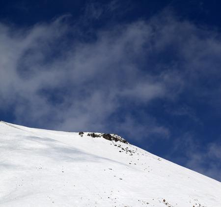 offpiste: Off-piste slope with stones at windy day. Caucasus Mountains, Georgia, ski resort Gudauri. Stock Photo