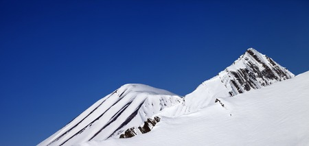 offpiste: Panoramic view on off-piste slope and blue clear sky in nice day. Caucasus Mountains, Georgia, ski resort Gudauri.