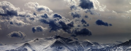 snow capped mountain: Panoramic view on evening mountains and cloudy sky. Caucasus Mountains. Georgia, view from ski resort Gudauri.