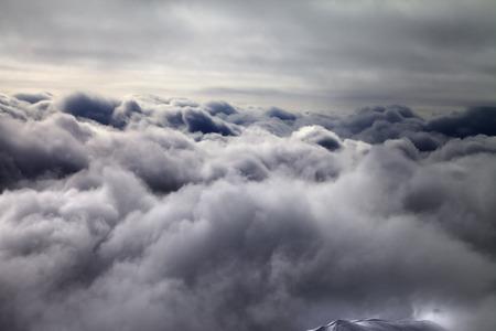 murky: Top of off-piste slope in storm clouds. Georgia, ski resort Gudauri. Caucasus Mountains. Stock Photo