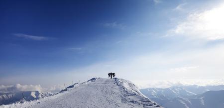 station ski: Panoramic view on top station of ropeway. Caucasus Mountains, Georgia, ski resort Gudauri, Mt. Sadzele. Stock Photo