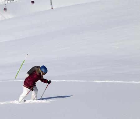 offpiste: Little skier on off-piste slope with new fallen snow at nice sun day. Caucasus Mountains, Georgia, ski resort Gudauri. Stock Photo