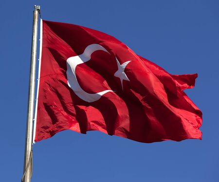 Turkish flag waving in wind at sunny day. Close-up view. Stock Photo