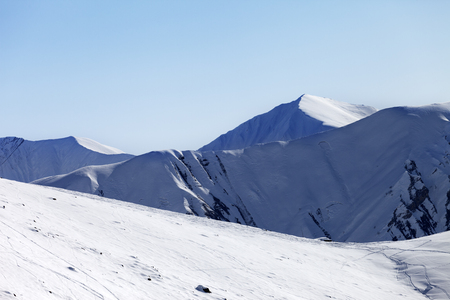 offpiste: Off-piste slope at nice sunny morning. Georgia, region Gudauri. Caucasus Mountains.