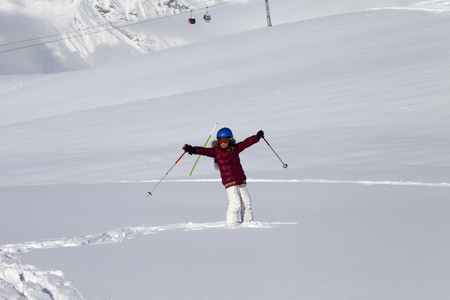 offpiste: Happy girl on off-piste slope with new fallen snow at nice sun day. Caucasus Mountains, Georgia, region Gudauri.