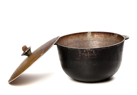 smut: Open old black pot with lid isolated on white background