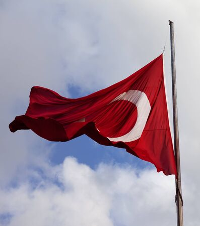 brandish: Turkish flag on flagpole at windy day. Close-up view Stock Photo