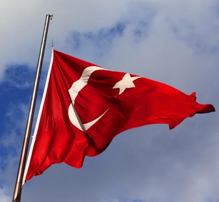 turk: Turkish flag on flagpole at windy sun day Stock Photo
