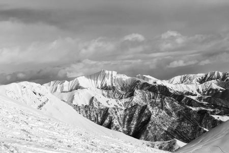 off piste: Black and white snowy mountains. Caucasus Mountains, Georgia, region Gudauri. Stock Photo