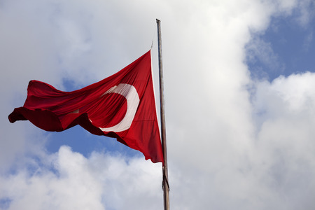 Turkish flag on flagpole at windy day Stock Photo