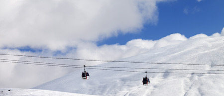 offpiste: Panoramic view on gondola lifts and off-piste slope at sun day. Caucasus Mountains, Georgia, region Gudauri.