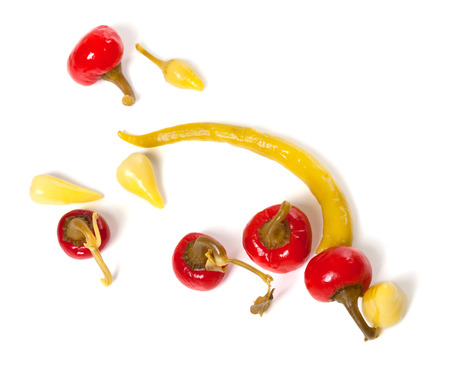chili pepper: Mix of hot turkish marinated peppers isolated on white background. Top view. Stock Photo