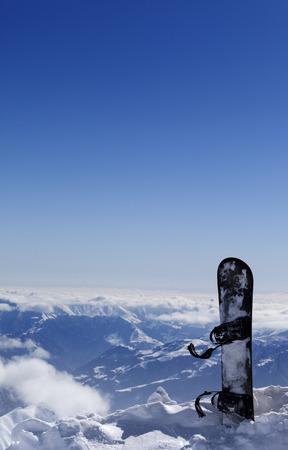 offpiste: Snowboard in snow on off-piste slope at sun day. Caucasus Mountains, Georgia, region Gudauri.