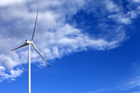 kinetic energy: Wind turbine and blue sunlight sky with clouds Stock Photo